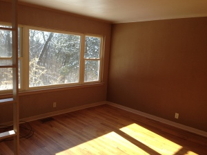 The living room actually has pretty nice floors and a beautiful view.  It needed a fresh coat of paint.
